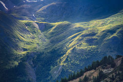 Mountain slope in the sunlight Stock Images