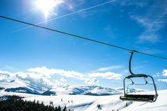 Mountain slopes with chairlift Stock Photo