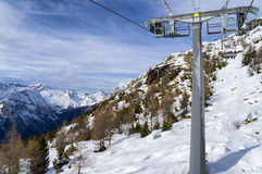 Mountain slopes and chairlift in winter Stock Photo