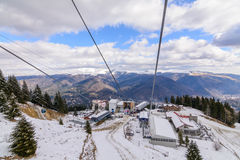 Mountain slopes with chairlift on a winter sunny day. Winter mou Stock Photo
