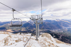 Mountain slopes with chairlift on a winter sunny day Winter moun Royalty Free Stock Image
