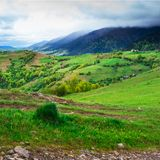 Mountain slopes with green meadow Royalty Free Stock Photos