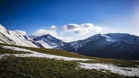 Mountain slopes and peaks Stock Photos