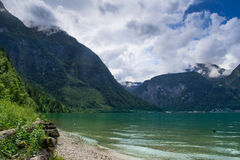Mountain and small village. Beautiful Austrian mountains and lake Royalty Free Stock Photos
