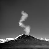 Mountain with smoke Stock Images