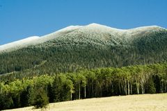 Mountain snow. A dusting of snow on mountain peaks Stock Images