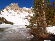 Mountain Snow. With a frozen lake taken in the Sierra Nevada Mountains near Kings Canyon National Park, CA Stock Photography