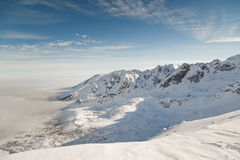 Mountain snow-capped peaks in bright sunny weather. A delightful winter landscape Stock Photography