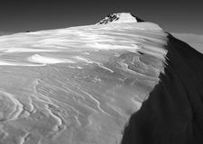 Mountain With Snow Cornice. Mountain range with cornice overhanging rock Royalty Free Stock Image