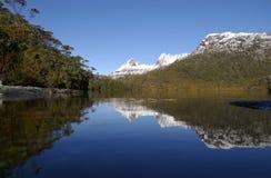 Mountain Snow Covered Cradle Mountain Tasmania Aus. Reflection of snow covered Cradle Mountain in lake Stock Images