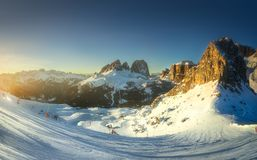Mountain and spine of Dolomiti covered with snow. Mountain snow landscape and spine of Dolomiti with freeride skiers, Italy royalty free stock photography