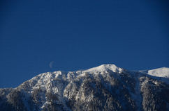 Mountain with snow and moon Royalty Free Stock Photo