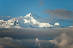 Mountain snow peak cloudy cover stock images