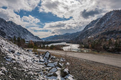 Mountain snow river road sky autumn Royalty Free Stock Photos