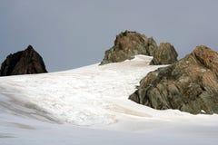 Mountain Snow and rocks Stock Photos