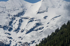 mountain with snow and rocks stock images