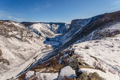 Mountain snow winter valley river Stock Images