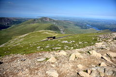 Mountain in Snowdonia. Great trip to the top of Snowdon in Wales. climbing, swimming in lakes, beautiful summer weather, the sun blue sky low clouds, adventure Stock Image