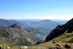 Mountain in Snowdonia. Great trip to the top of Snowdon in Wales. climbing, swimming in lakes, beautiful summer weather, the sun blue sky low clouds, adventure Stock Photos