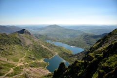 Mountain in Snowdonia. Great trip to the top of Snowdon in Wales. climbing, swimming in lakes, beautiful summer weather, the sun blue sky low clouds, adventure Stock Photography