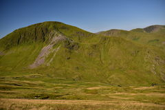 Mountain in Snowdonia. Great trip to the top of Snowdon in Wales. climbing, swimming in lakes, beautiful summer weather, the sun blue sky low clouds, adventure Royalty Free Stock Image