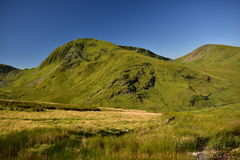 Mountain in Snowdonia. Great trip to the top of Snowdon in Wales. climbing, swimming in lakes, beautiful summer weather, the sun blue sky low clouds, adventure Royalty Free Stock Images