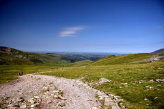 Mountain in Snowdonia. Great trip to the top of Snowdon in Wales. climbing, swimming in lakes, beautiful summer weather, the sun blue sky low clouds, adventure Royalty Free Stock Photo