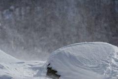 Mountain while snowing Stock Photos