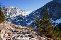 Mountain snowy landscape with rock path Stock Photography