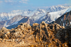 Mountain snowy landscape with rock Royalty Free Stock Photo