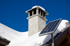 Mountain solar panel. A small solar panel installed on a mountain house roof Royalty Free Stock Photography