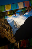 A mountain in Southern Tibet with Prayer Flags Stock Image