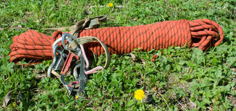 Mountain sporting equipment. On a green lawn Royalty Free Stock Photography