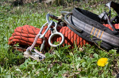 Mountain sporting equipment. On a green grass Stock Images