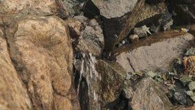 Water flowing rocks stock footage