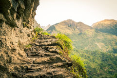 Mountain stairs made of stone in the Annapurnas circuit. Nepalese village at Annapurnas area, Himalayas, Nepal Stock Photography