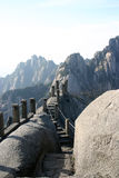 Mountain stairway. Rock stairway and path through high, rugged Chinese mountains Stock Photos