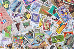 Mountain of stamps. Set of various stamps from around the world - circa 1971-1978: A post stamp printed in the world shows image Stock Images
