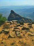 Mountain standing tall. A pointy mountain at hill station royalty free stock photography
