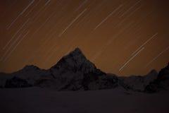 Mountain with star in night time. Himalaya mountain with star in night time Royalty Free Stock Images