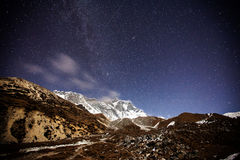 Mountain with star in night time Stock Images