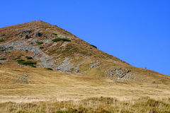 Mountain steep slope on blue sky. Very steep slope seen on blue sky in Parang mountains, Romania stock photography