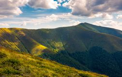 Mountain Stij under the cloudy summer sky. Stij peak under the cloudy summer sky. beautiful landscape of Carpathian mountains. great destination to travel royalty free stock images
