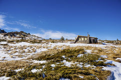 Mountain stone shelter in the Winter mountain. Mountain stone Huts During Winter royalty free stock photography