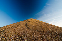 Mountain of stones against the sky.  Royalty Free Stock Photography