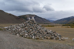 Mountain stones in Mongolia. A pile of stones on a background of mountains in Mongolia Stock Photography