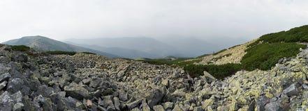 Mountain stony overcast view. Mountain stony and overcast panorama (Gorgany region of Carpathian mountains, Ukraine). Fifty shots composite picture Stock Photos