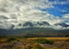 Mountain storm clouds. Lourensford wine estate mountains and a storm is rolling in stock image
