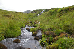 Mountain stream. A blurred rushing mountain stream royalty free stock photos