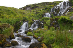 Mountain stream. A blurred rushing mountain stream stock photos